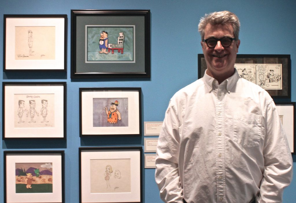 Fred Seibert with a few drawings from one of his favorite cartoon series, 'The Flintstones'. Photo by Marisa Losciale